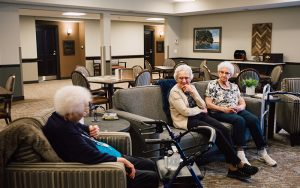 Pelican Landing Residents socialicing in a community room